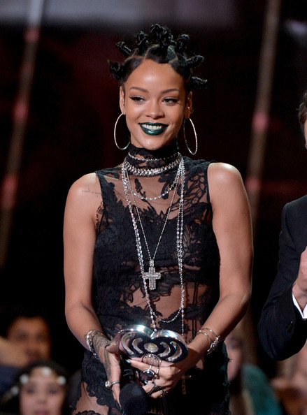 Singer Rihanna accepts the Artist of the Year award onstage during the 2014 iHeartRadio Music Awards held at The Shrine Auditorium on May 1, 2014 in Los Angeles, California