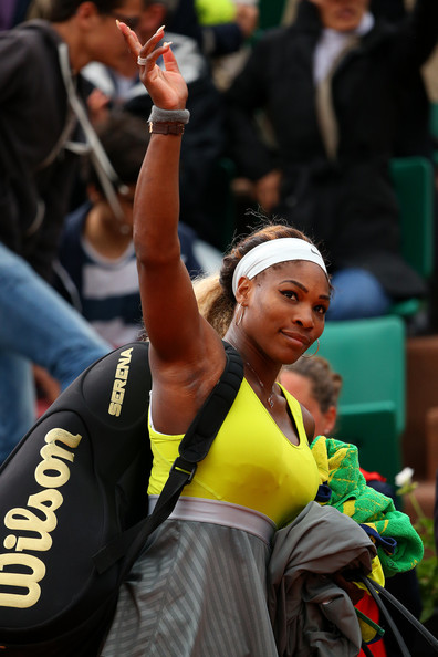 Serena Williams of the United States waves to the crowd as she leaves the court following her defeat in the women's singles match against Garbine Muguruza of Spain on day four of the French Open at Roland Garros on May 28, 2014 in Paris, France