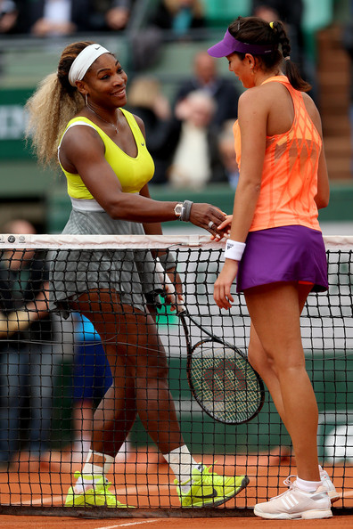 Garbine Muguruza of Spain shakes hands with Serena Williams of the United States at the net following her victory in their women's singles match on day four of the French Open at Roland Garros on May 28, 2014 in Paris, France