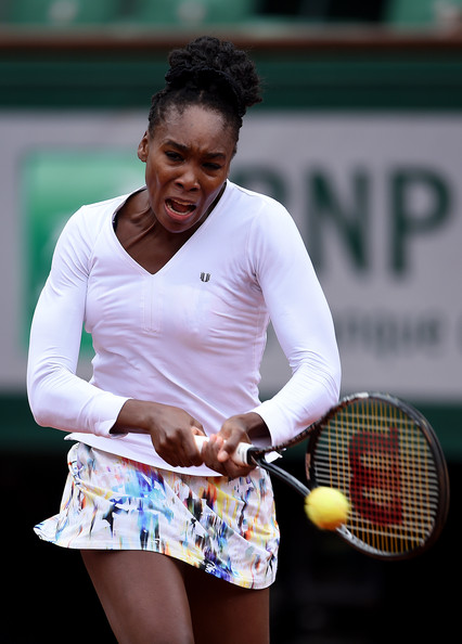 Venus Williams of the United States returns a shot during her women's singles match against Anna Schmiedlova of Slovakia on day four of the French Open at Roland Garros on May 28, 2014 in Paris, France