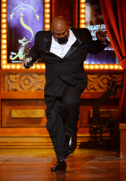 "James Monroe Iglehart accepts the award for Best Performance by an Actor in a Featured Role in a Musical for ""Aladdin"" onstage during the 68th Annual Tony Awards at Radio City Music Hall on June 8, 2014 in New York City"