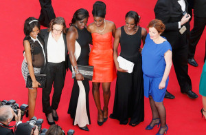 "Director Celine Sciamma (2ndL) and cast members of her film ""Bandes de filles"" (Girlhood) pose on the red carpet as they arrive for the screening of the film ""How to Train Your Dragon 2"" out of competition at the 67th Cannes Film Festival in Cannes May 16, 2014."