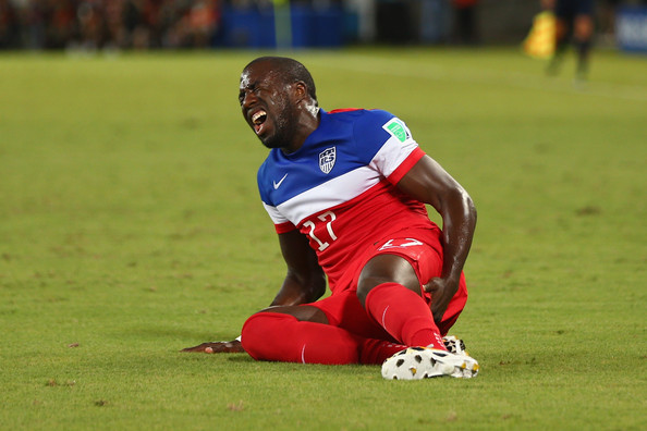 An injured Jozy Altidore of the United States lies on the field during the 2014 FIFA World Cup Brazil Group G match between Ghana and the United States at Estadio das Dunas on June 16, 2014 in Natal, Brazil