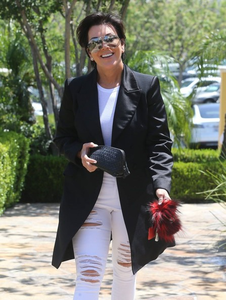 Reality star Kris Jenner is all smiles while heading to lunch at Sugar Fish in Calabasas, California on June 6, 2014