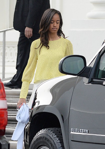 Malia Obama leaves the North Portico of the White House to attend a Church service April 20 2014 in Washington, DC