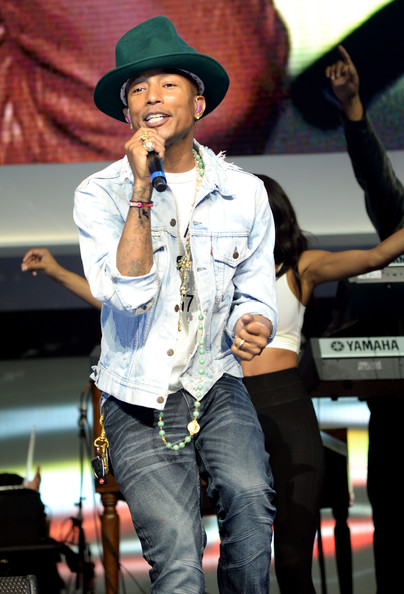 Pharrell Williams performs during the Walmart 2014 Annual shareholders' meeting at Bud Walton Arena at the University of Arkansas on June 6, 2014 in Fayetteville, Arkansas