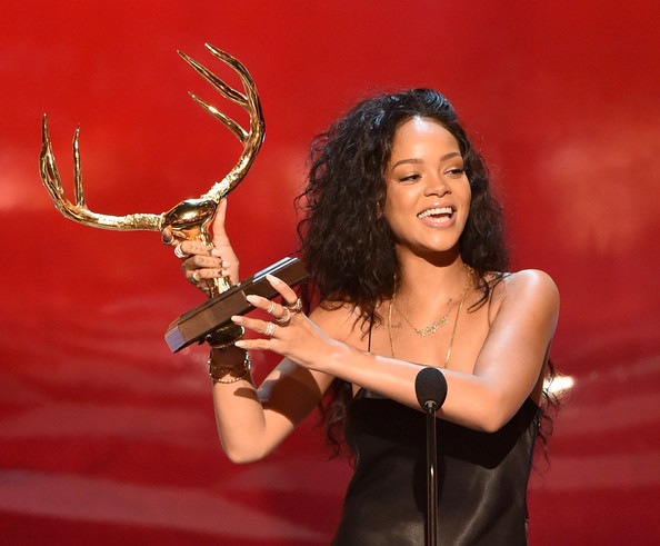 "Singer Rihanna accepts the Most Desirable Woman award onstage during Spike TV's ""Guys Choice 2014"" at Sony Pictures Studios on June 7, 2014 in Culver City, California"