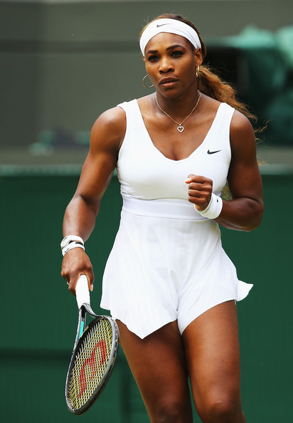 Serena Williams of the United States in action during her Ladies' Singles second round match against Chanelle Scheepers of South Africa on day four of the Wimbledon Lawn Tennis Championships at the All England Lawn Tennis and Croquet Club at Wimbledon on June 26, 2014 in London, England.