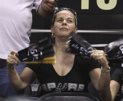A Spurs fan fans herself after the air condition went out in the facility during Game 1 of the 2014 NBA Finals at the AT&T Center on Thursday, June 5, 2014