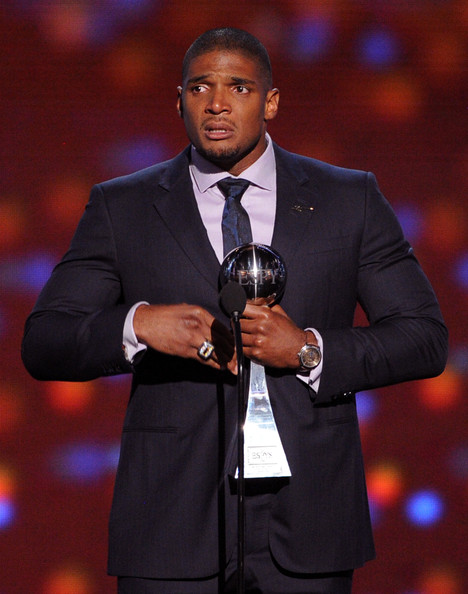 NFL player Michael Sam accepts the Arthur Ashe Courage Award onstage during the 2014 ESPYS at Nokia Theatre L.A. Live on July 16, 2014 in Los Angeles, California