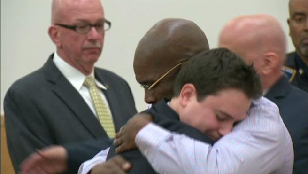 Jonathan Fleming embraces a member of his legal team