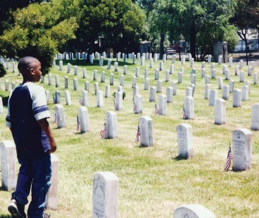 A youth visits the graves of the fallen sailors of the   Port Chicago tragedy of 1944.
