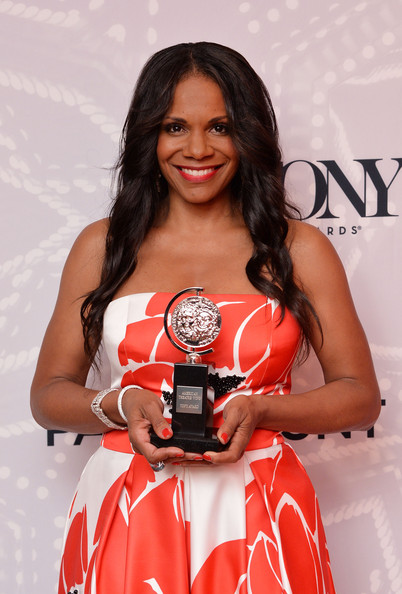 """Audra McDonald, winner of the award for Best Performance by an Actress in a Leading Role in a Play for """"Lady Day"""", poses in the Paramount Hotel Winners' Room at the 68th Annual Tony Awards on June 8, 2014 in New York City"""