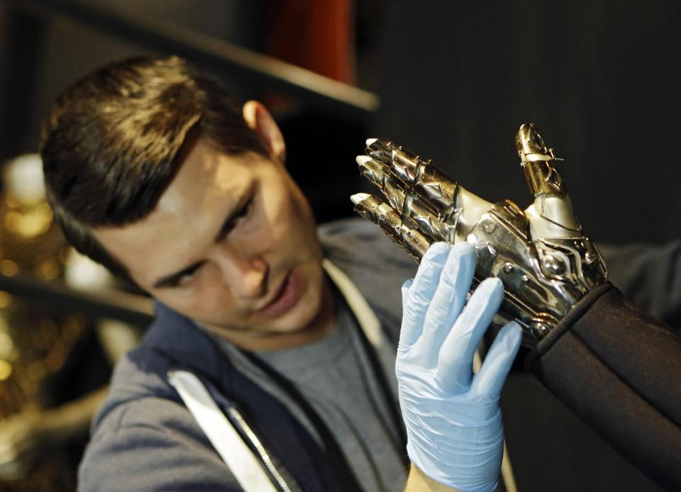 "In this Thursday, july 17, 2014 photo, Matt Seaman adjust the glove from Beyoncé's ""Single Ladies"" outfit during installation at the Rock and Roll Hall of Fame in Cleveland."