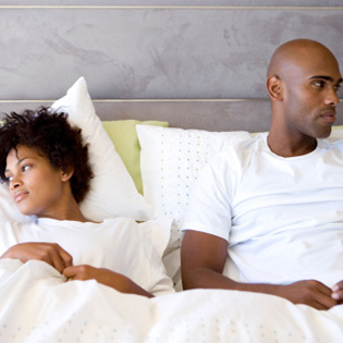 couple-in-bed-frustrated-article