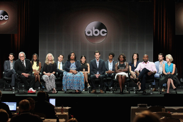 (Top L-R) Actors Jack Falahee, Aja Naomi King, Matt McGorry, Karla Souza, Alfred Enoch, Katie Findley, Charlie Weber, (Front L-R) Director/Executive Producer Bill D'Elia, Executive producers Betsy Beers, Shonda Rhimes, Creator/Executive producer Pete Nowalk, actors Viola Davis, Billy Brown and Liza Weil speak onstage at the 'How To Get Away With Murder'' panel during the Disney/ABC Television Group portion of the 2014 Summer Television Critics Association at The Beverly Hilton Hotel on July 15, 2014 in Beverly Hills, California