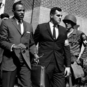 James Meredith, center with briefcase, is escorted to the University of Mississippi campus by U.S. marshals on Oct. 1, 1962.