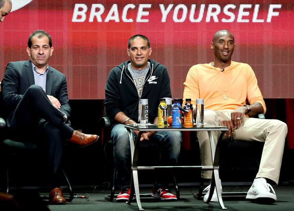 "(L-R) EVP and General Manager of Showtime Sports & Event Programming Stephen Espinoza, producer Gotham Chopra, and professional basketball player Kobe Bryant speak onstage at the ""Kobe Bryant's Muse"" panel during the El Rey Network portion of the 2014 Summer Television Critics Association at The Beverly Hilton Hotel on July 18, 2014 in Beverly Hills, California"