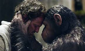 (L to R) Jason Clarke and Andy Serkis as Caesar stars in the 20th Century Fox presentation of Dawn of the Planet of the Apes.