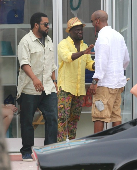 Actors Kevin Hart and Ice Cube film a scene on the set of 'Ride Along 2' on July 7, 2014 in Miami, Florida.