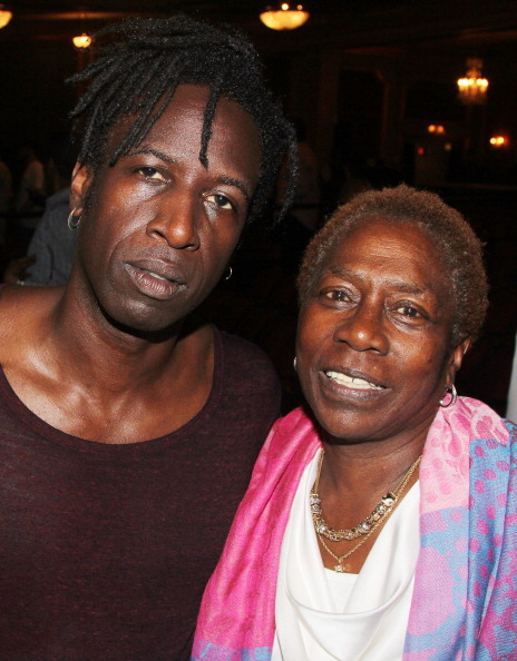Saul Williams (who plays the Poet who mirrors Tupac Shakur) and Afeni Shakur (Tupac Shakur's mother) pose backstage on Tupac's 43rd birthday at the new Tupac Shakur composed musical 'Holler If Ya Hear Me' on Broadway at The Palace Theater on June 16, 2014 in New York City.