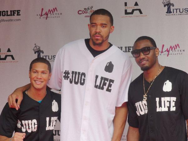 (From middle to right) Former Washington Wizards teammates JaVale McGee and John Wall pose with elated fan.
