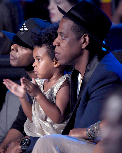 Jay Z and Blue Ivy watch Beyonce perform during the 2014 MTV VMAs on Aug. 24, 2014