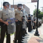 Mike Brown: Cyberactivists Post Dispatch Tapes; Vow to ID Cop Shooter