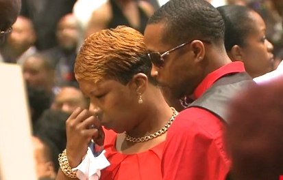 Lesley McSpadden looks at the body of her son Michael Brown at his funeral Monday morning at Friendly Temple Missionary Baptist Church in St. Louis.