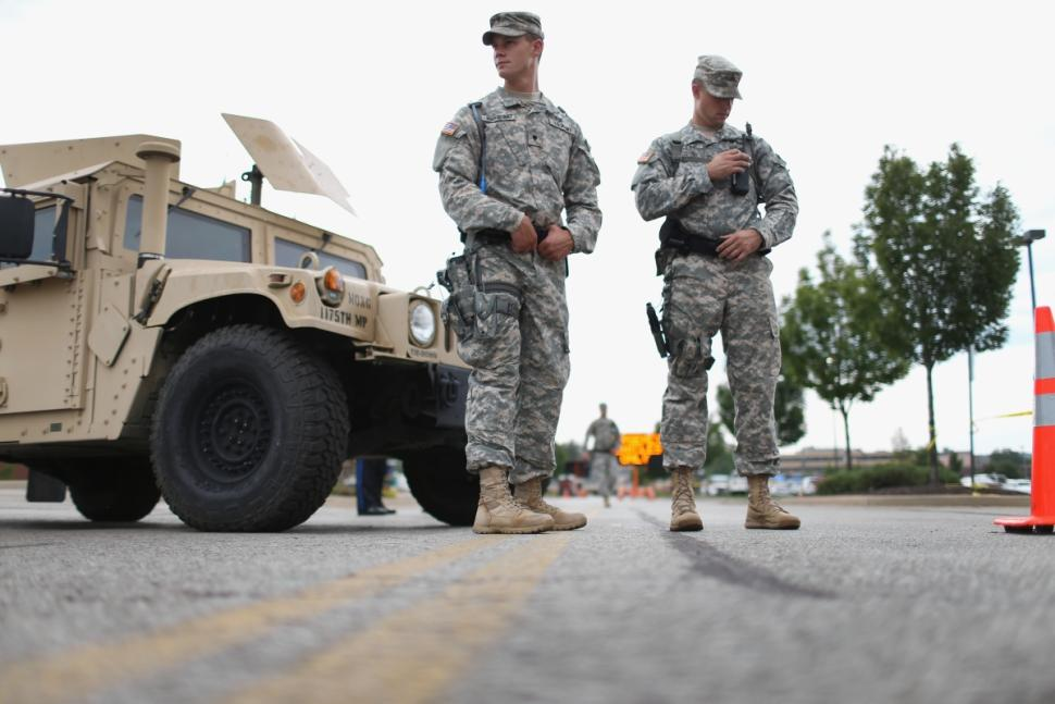 National Guard troops deployed in Ferguson, Missouri to provide protection for a police command center Tuesday, Aug. 19
