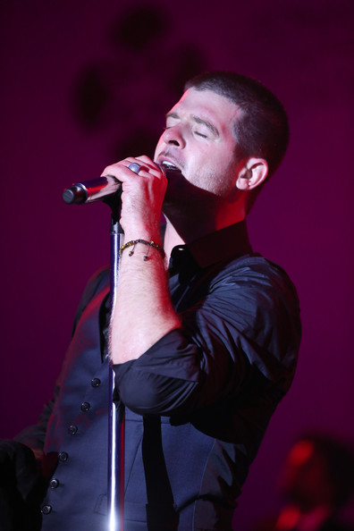 In this handout provided by the Leonardo Dicaprio Foundation, Robin Thicke performs onstage during the Leonardo Dicaprio Foundation Inaugurational Gala at Domaine Bertaud Belieu on July 23, 2014 in Saint-Tropez, France