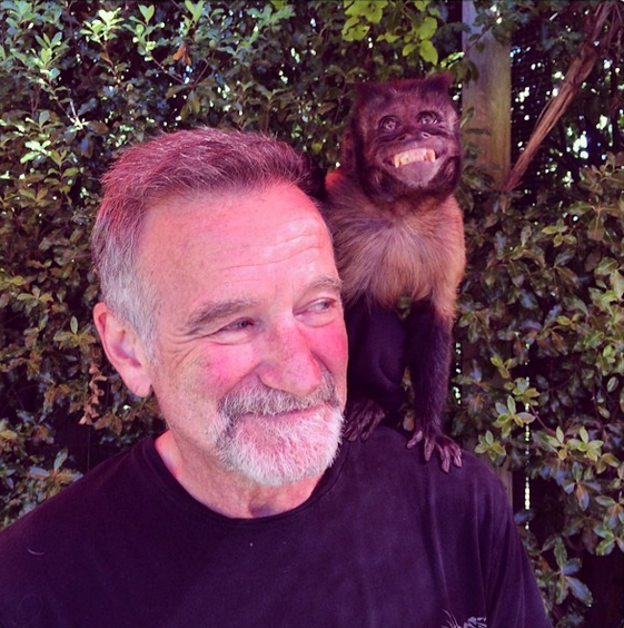 "Robin Williams celebrated his birthday on July 21, and posted this pic on Instagram with his ""favorite leading lady"" Crystal"