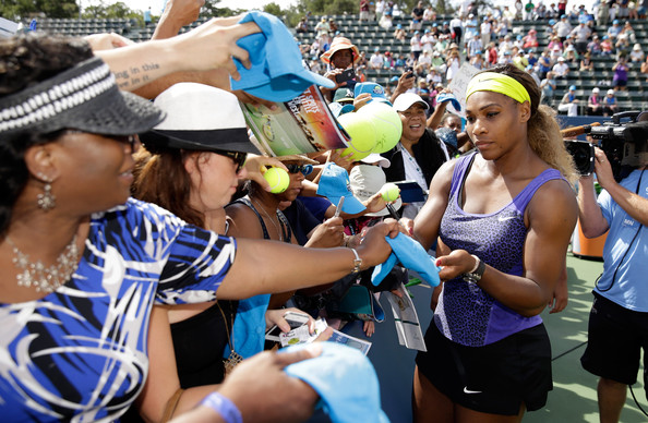 Serena Williams of the USA signs autographs after beating Angelique Kerber of Germany in the finals of the Bank of the West Classic at the Taube Family Tennis Stadium on August 3, 2014 in Stanford, California