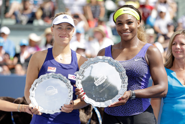 Serena Williams of the USA and Angelique Kerber of Germany hold up their trophies after Williams won the finals of the Bank of the West Classic at the Taube Family Tennis Stadium on August 3, 2014 in Stanford, California