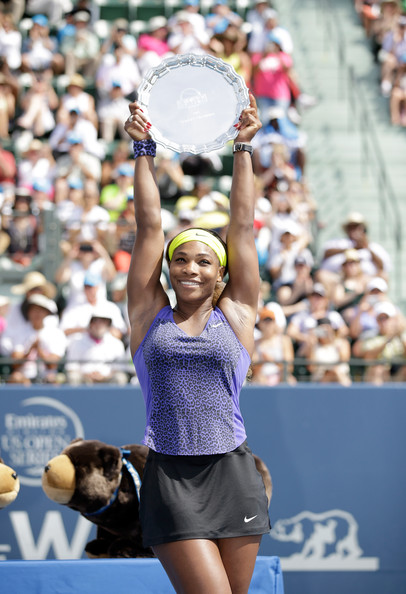 Serena Williams of the USA holds up the trophy after beating Angelique Kerber of Germany in the finals of the Bank of the West Classic at the Taube Family Tennis Stadium on August 3, 2014 in Stanford, California