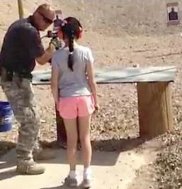 shooting instructor & 9 yr old girl
