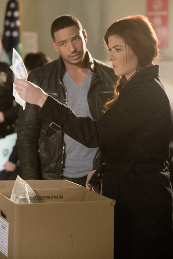 "Laz Alonso and Debra Messing in the pilot episode of NBC's ""The Mysteries of Laura"""