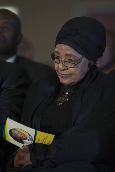 Winnie Mandela attends an African National Congress (ANC) led alliance send off ceremony for former South African President Nelson Mandela at Waterkloof military airbase on December 14, 2013 in Pretoria, South Africa.