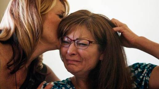 Susan Hunt is consoled by her sister, Cindy Moss, after Utah police shot and killed her son, Darrien Hunt