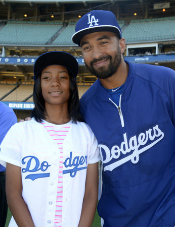Taney Dragons' Little League World Series pitcher Mo'ne Davis (left) poses with Los Angeles Dodgers center fielder Matt Kemp before Tuesday night's game against the Washington Nationals at Dodger Stadium