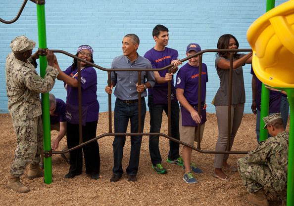 President Barack Obama and Michelle Obama take part in a service project at the Inspired Teaching School to mark the September 11th National Day of Service and Remembrance on September 11, 2014 in Washington, DC.