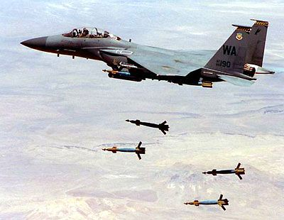 fighter jet dropping bombs