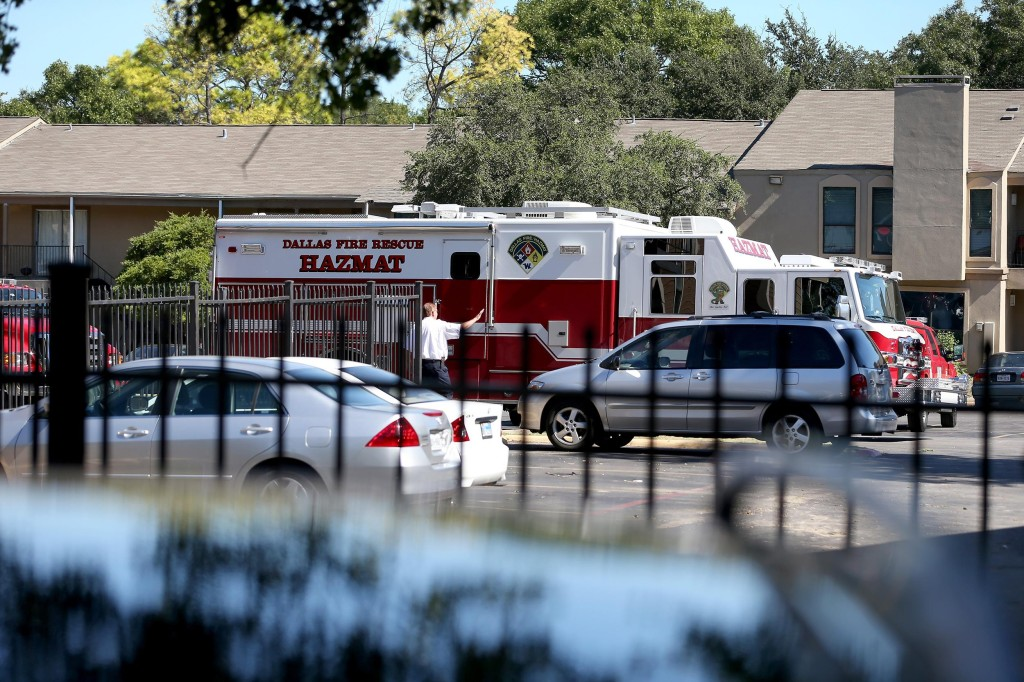 A hazmat truck is seen near the unit at the Ivy Apartments, where the Ebola virus patient Thomas Eric Duncan was staying in Dallas, Texas.