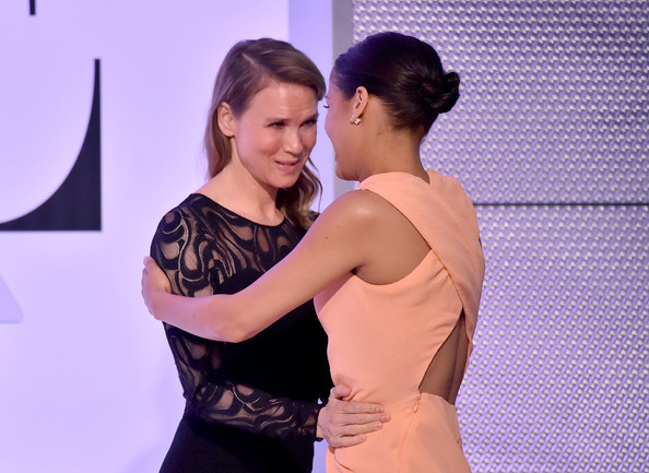 Actress Renee Zellweger (L) and honoree Gugu Mbatha-Raw speak onstage during ELLE's 21st Annual Women in Hollywood Celebration at the Four Seasons Hotel on October 20, 2014 in Beverly Hills, California