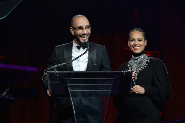 Swizz Beatz and Alicia Keys talk on stage at Angel Ball 2014 hosted by Gabrielle's Angel Foundation at Cipriani Wall Street on October 20, 2014 in New York City