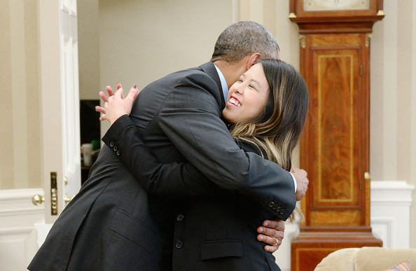 U.S. President Barack Obama gives a hug to Dallas nurse Nina Pham in the Oval Office of the White House October 24, 2014 in Washington, DC. Pham, a nurse who was infected with Ebola from treating patient Thomas Eric Duncan at Texas Health Presbyterian Hospital in Dallas and was first diagnosed on October 12, was declared free of the virus on Friday