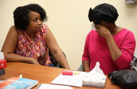 "Patricia Moore, left, talks to her daughter, beauty blogger Tameka Moore, known as ""Meechy Monroe"" in her blog"