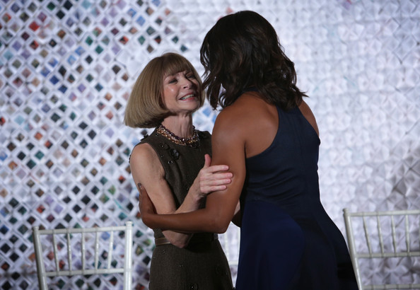 U.S. first lady Michelle Obama (R) hugs Anna Wintour (L), Editor-in-Chief of Vogue magazine, after she was introduced by Wintour during a session of a Fashion Education Workshop, hosted by first lady Michelle Obama, in the East Room of the White House October 8, 2014 in Washington, DC