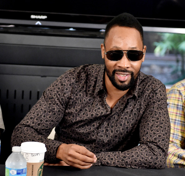 Rapper RZA of the Wu-Tang Clan poses at a press conference to announce they have signed with Warner Bros. Records at Warner Bros. Records on October 2, 2014 in Burbank, California