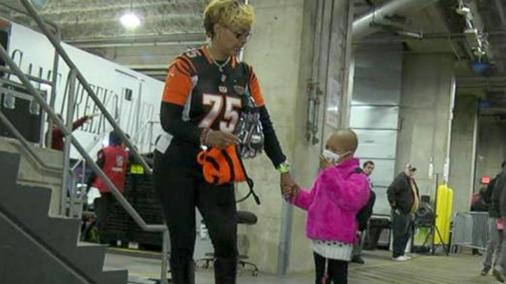 Leah Still prepares to watch her father, Cincinnati Bengals player Devon Still, play against the Cleveland Browns, Nov. 6, 2014, in Cincinnati. NFL Network